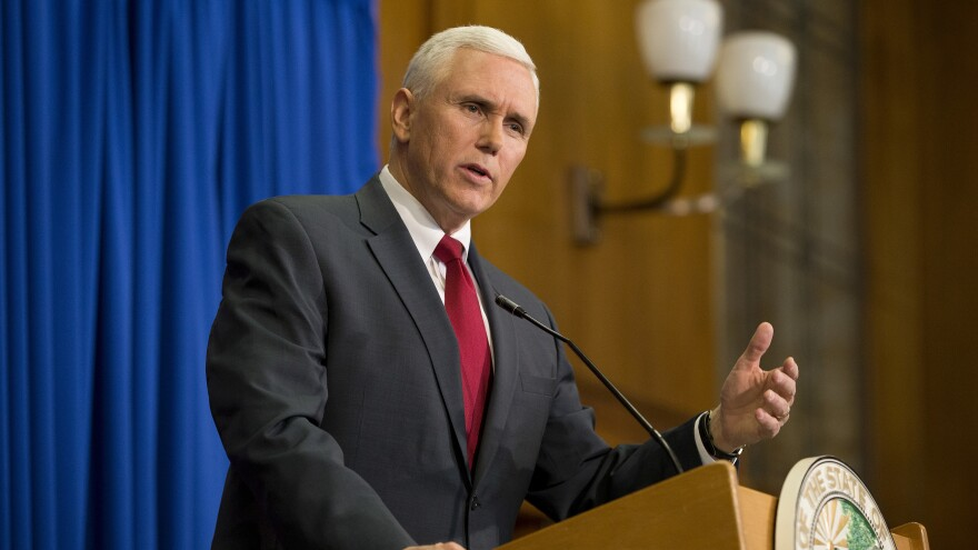 Then-Gov. Mike Pence of Indiana speaks at a press conference in 2015. Under Indiana law, public officials are allowed to use personal email accounts; the practice can help them avoid using official accounts to conduct political business.