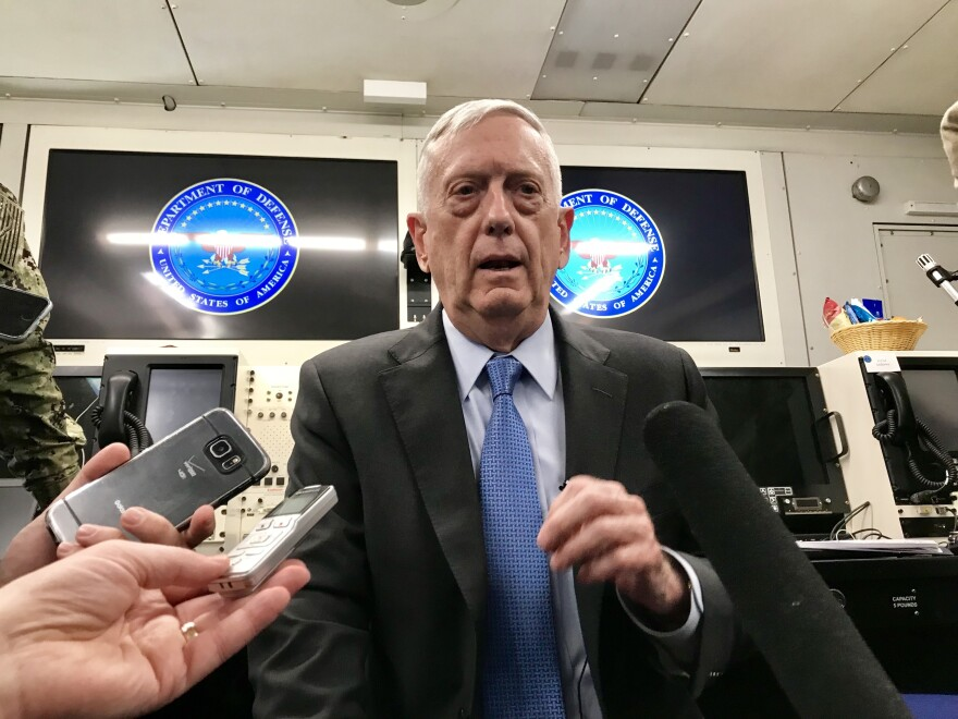 Defense Secretary Jim Mattis speaking to reporters aboard an armored version of a 747 which functions as an airborne command post.