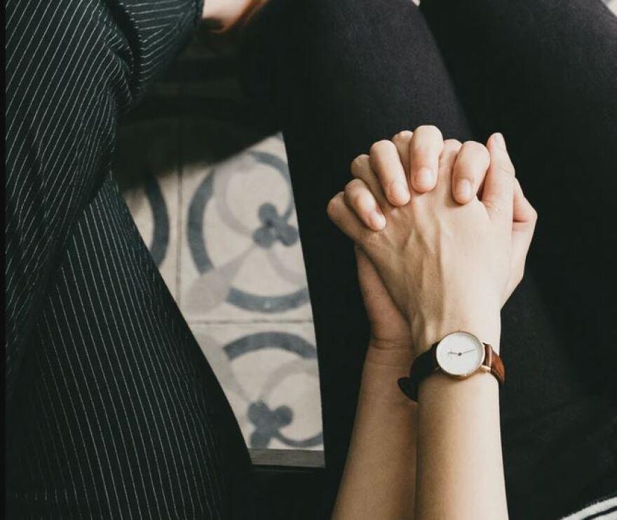 women holding hands unsplash.JPG