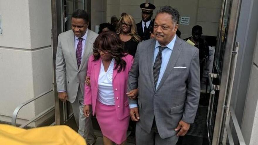 From left to right: Former Jacksonville City Councilman Reggie Brown, former congresswoman Corrine Brown and the Rev. Jesse Jackson are pictured during Corrine Brown's 2017 trial.