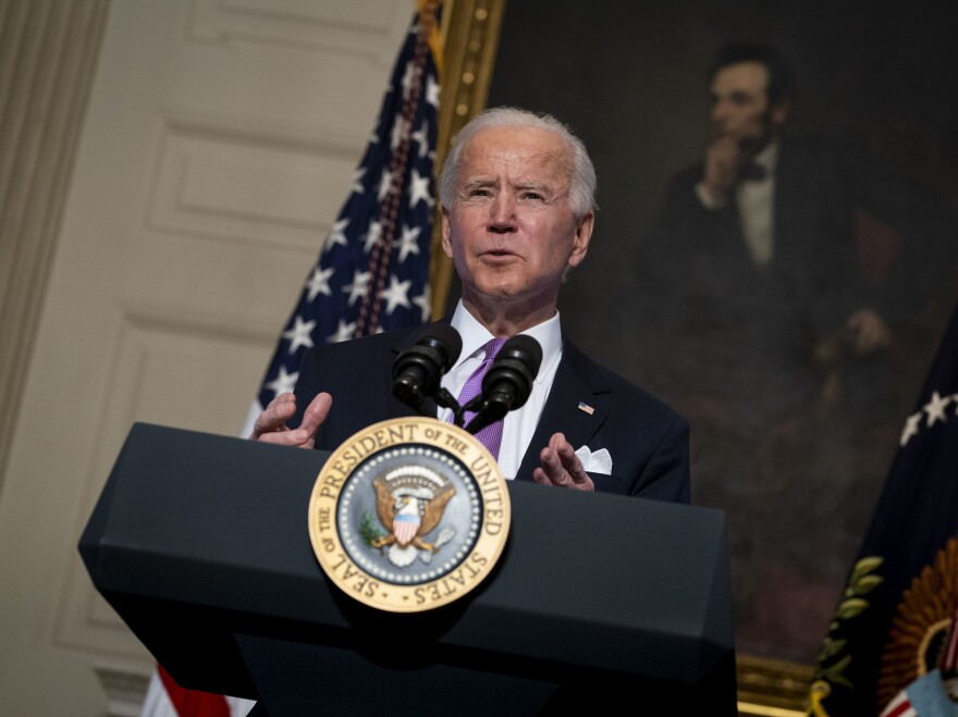 President Joe Biden speaks about the coronavirus pandemic in the State Dining Room of the White House on Tuesday.