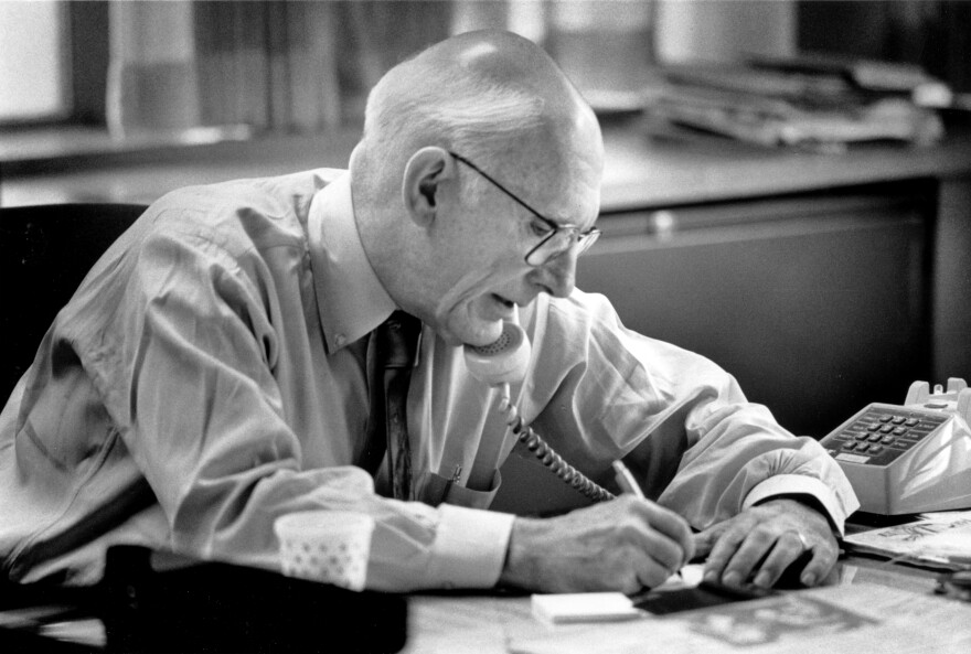Claude Sitton, then-editor of the <em>News & Observer</em>, works in his office at the newspaper in Raleigh, N.C., in 1990. Sitton, who was a leader among reporters covering the civil rights movement in the South in the 1950s and '60s and later won a Pulitzer Prize for distinguished commentary, died Tuesday, March 10, 2015. He was 89.