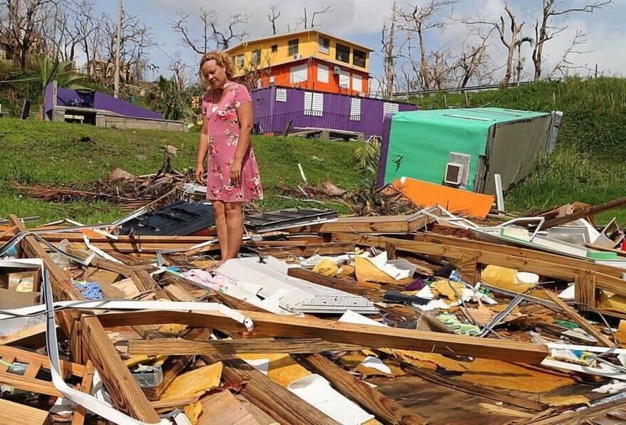 Principal Wanda Alvarez stands on the remains of the private school El Eden Paraiso Infantil in Yabucoa, Puerto Rico.