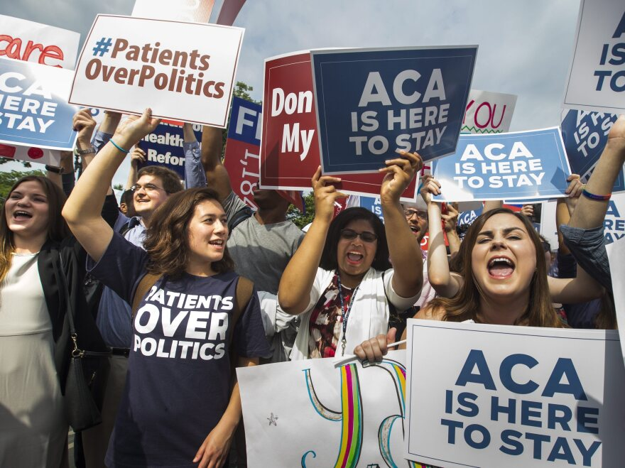 Supporters of the Affordable Care Act cheer outside the Supreme Court on Thursday after justices upheld the law's subsidies.