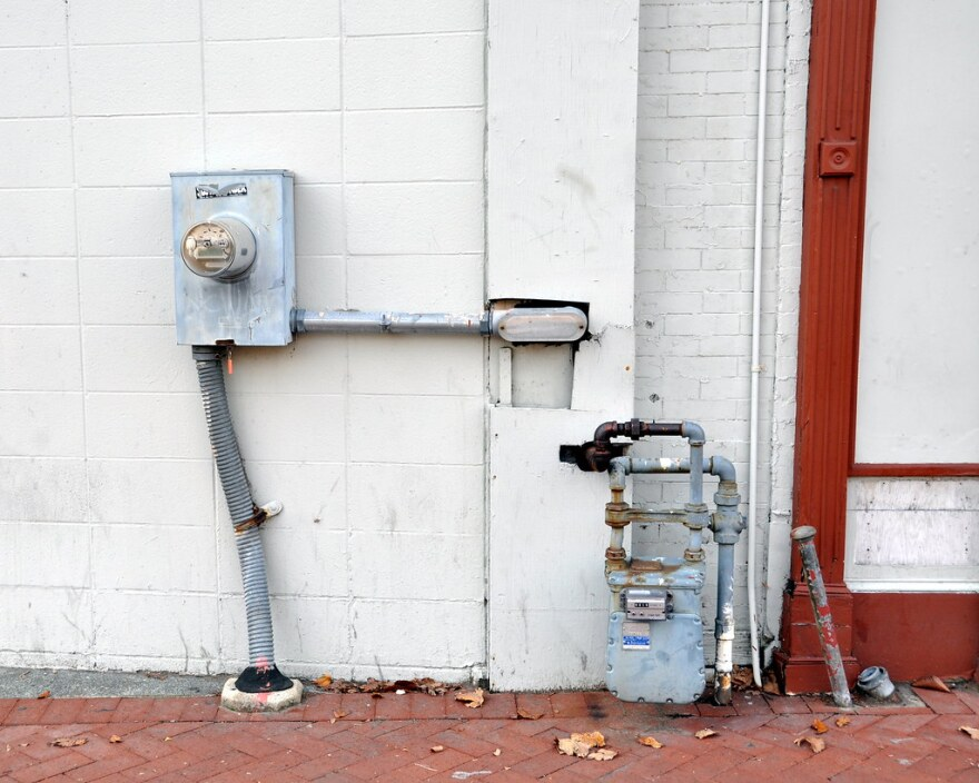 Power and gas meters attached to an old building.