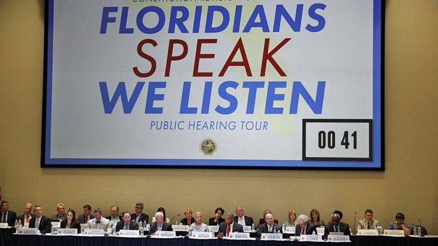 Members of the Constitutional Revision Commission listen to residents during a town hall meeting at Florida International University in Miami, April 6, 2017.