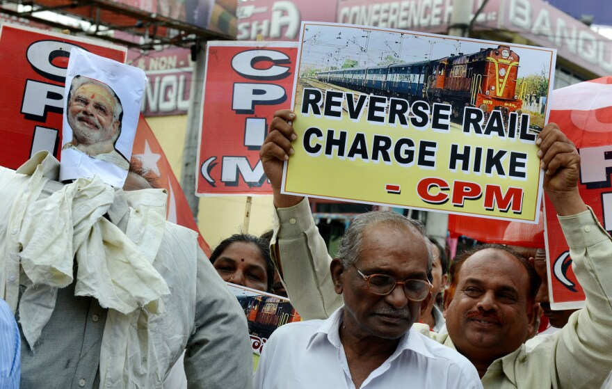 Indian activists of the Communist Party of India-Marxists (CPI-M) protest against a price hike in railway fares in Hyderabad, India, on June 21. The government subsequently rolled back a proposed fare increase.