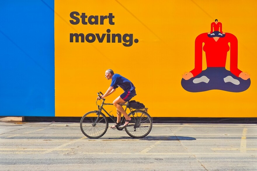 Cyclist with Start Moving Sign.jpg