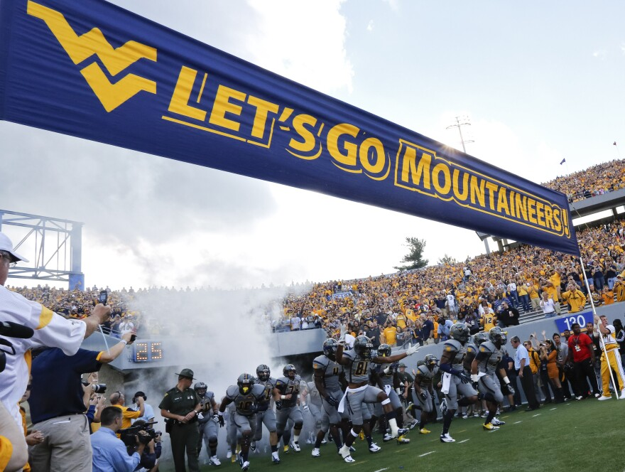 The West Virginia Mountaineers take the field during the NCAA college football game between West Virginia University and University of Maryland in Morgantown, W.Va., Saturday, Sept. 22, 2012.