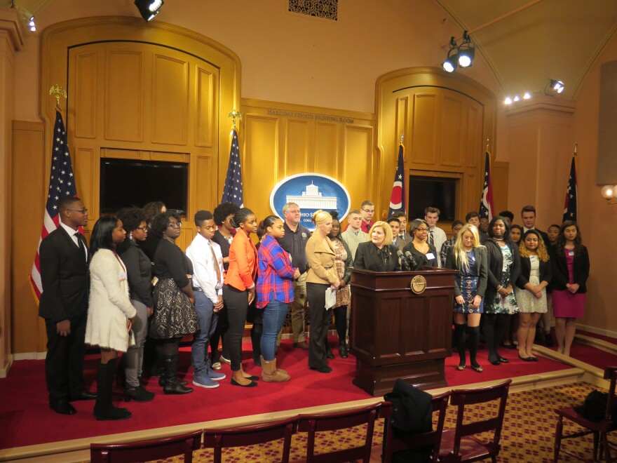 Photo of Rep. Teresa Fedor announcing proposal surrounded by students