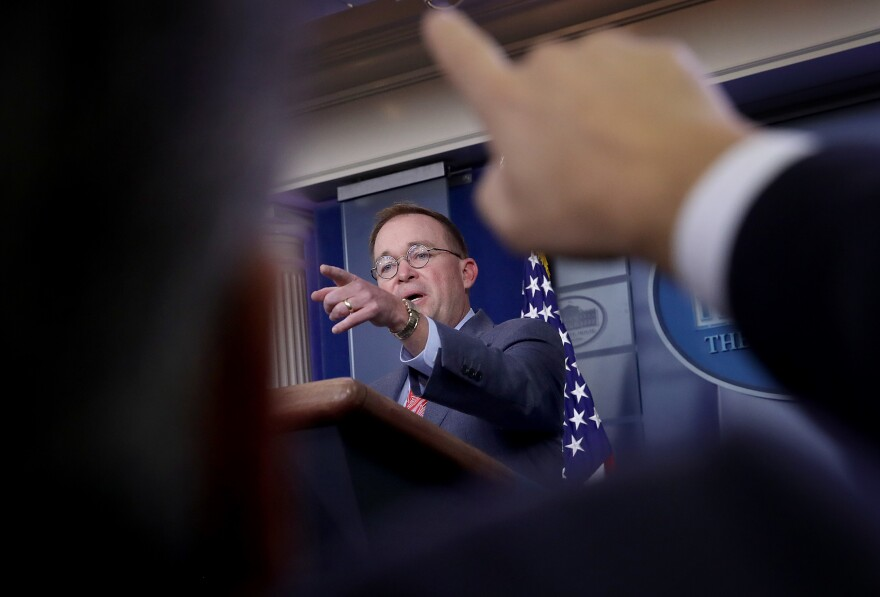 Acting White House chief of staff Mick Mulvaney answers questions during a press conference on Oct. 17.