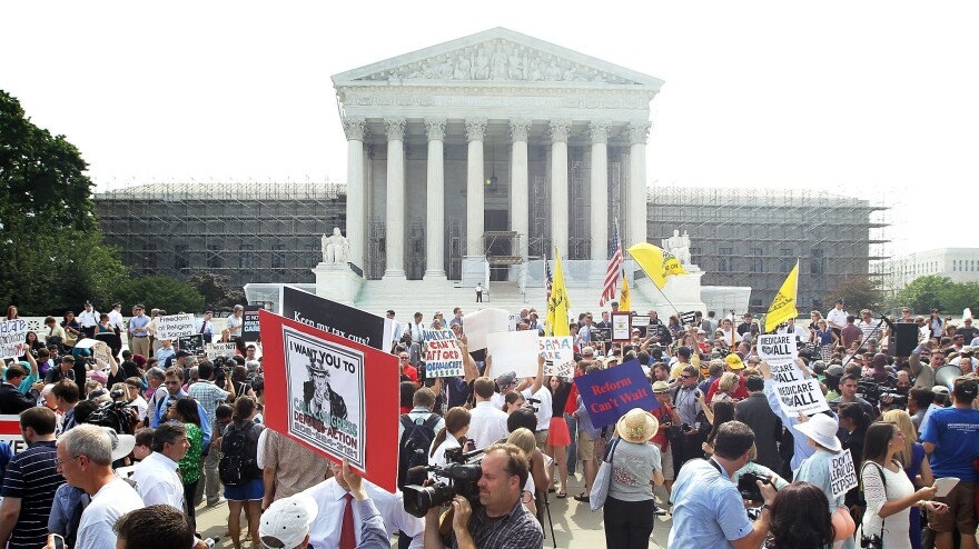 The scene outside the U.S. Supreme Court on Thursday, when the justices released their ruling on President Obama's health care law.