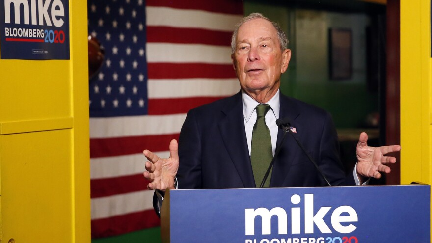 Former New York Mayor Mike Bloomberg speaks to the media in Phoenix. Bloomberg, who's running for president, is spending millions on TV ads but not competing in Iowa or New Hampshire.