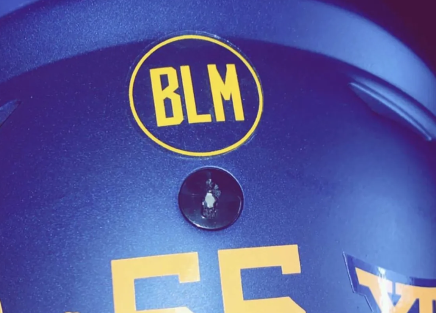 A sticker in support of Black Lives Matter can be seen in this cropped photo posted by West Virginia University defensive lineman Dante Stills to his Instagram account.