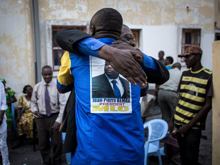 Jean-Pierre Bemba's supporters celebrate at the Congolese Liberation Movement, or MLC, headquarters upon learning Friday's verdict in Kinshasa.