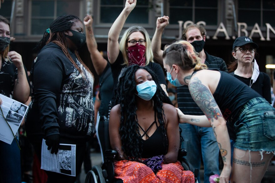 Whitney Mitchell mourns with supporters at a July 26 vigil for her fiancé Garrett Foster, who was shot and killed at a Black Lives Matters protest.