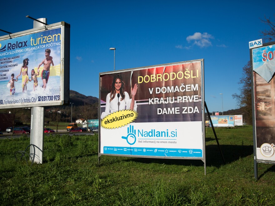 "A sign reading ""Welcome to the Hometown of the First Lady"" in Slovenian is pictured among other billboards in November 2016 in Sevnica, Slovenia, where Melania Trump was raised."
