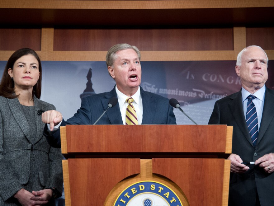 Sens. Kelly Ayotte, R-N.H., Lindsey Graham, R-S.C., and John McCain, R-Ariz., appear during a news conference Wednesday about the terrorist attack in Benghazi, Libya. Graham argued that Rice misled the public when addressing the attack, in which four Americans were killed.