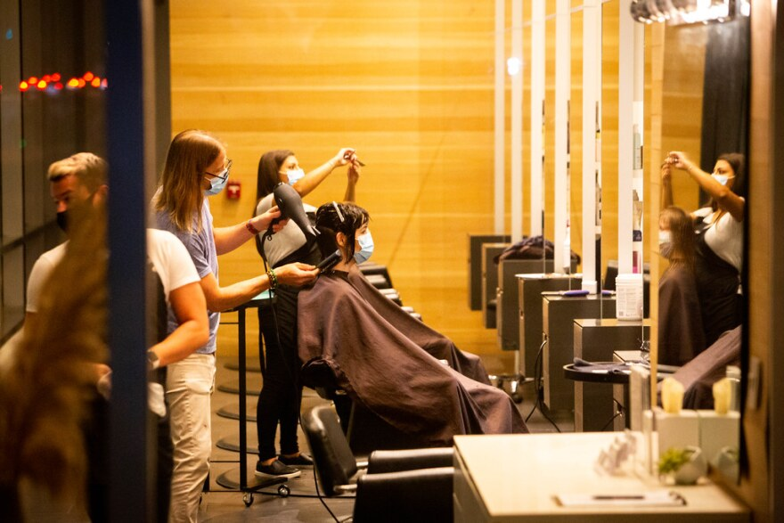 Stylists do customers' hair at Milk + Honey Spa.