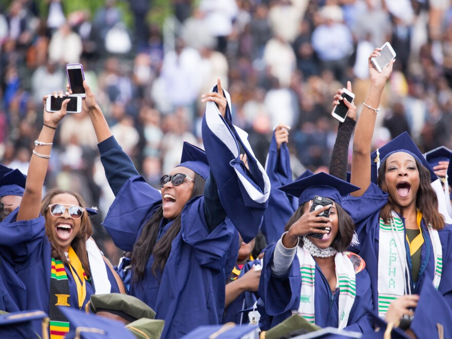 Howard University graduates celebrate at commencement in May 2016.