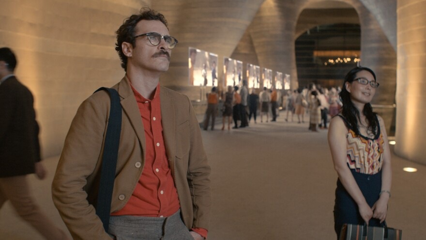 Joaquin Phoenix's <em>Her</em> character, Theodore, has a job writing intimate — and sometimes erotic — cards and letters on behalf of other people.