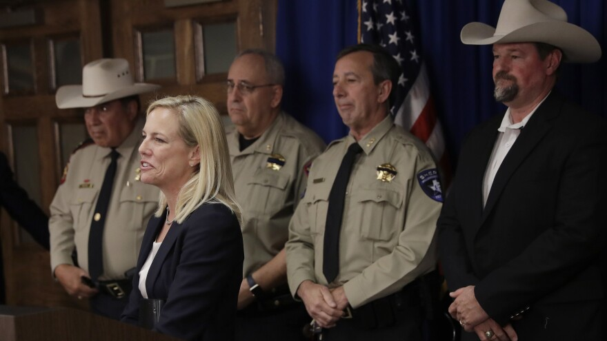 Secretary of Homeland Security Kirstjen Nielsen stands with a group of Texas sheriffs opposing sanctuary-city policies in December in Austin.