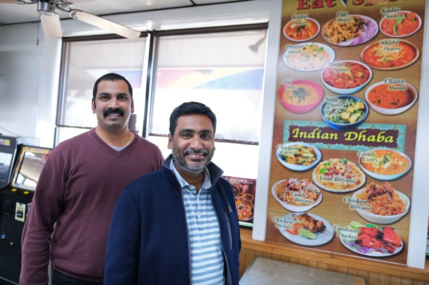 Co-owners Vamsi Yaramaka (left) and Raj Alturu stand inside Eat Spice on Oct. 24, in the truck stop on Route 534 off I-80 in White Haven, Pa. The restaurant caters to members of the Sikh community. For them, Indian and Mediterranean dishes can be hard to find on the road.
