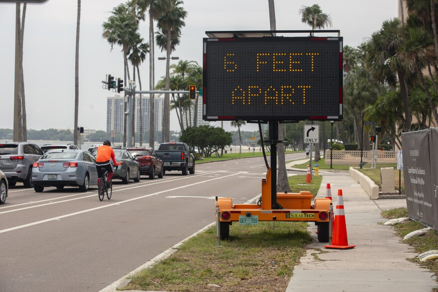Sign on Bayshore Boulevard says 6 Feet Apart