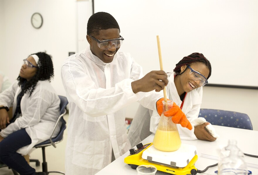 College Prep students DeAngelo Thomas and Cyan Lewis joke while working on a science experiment. June 7, 2017