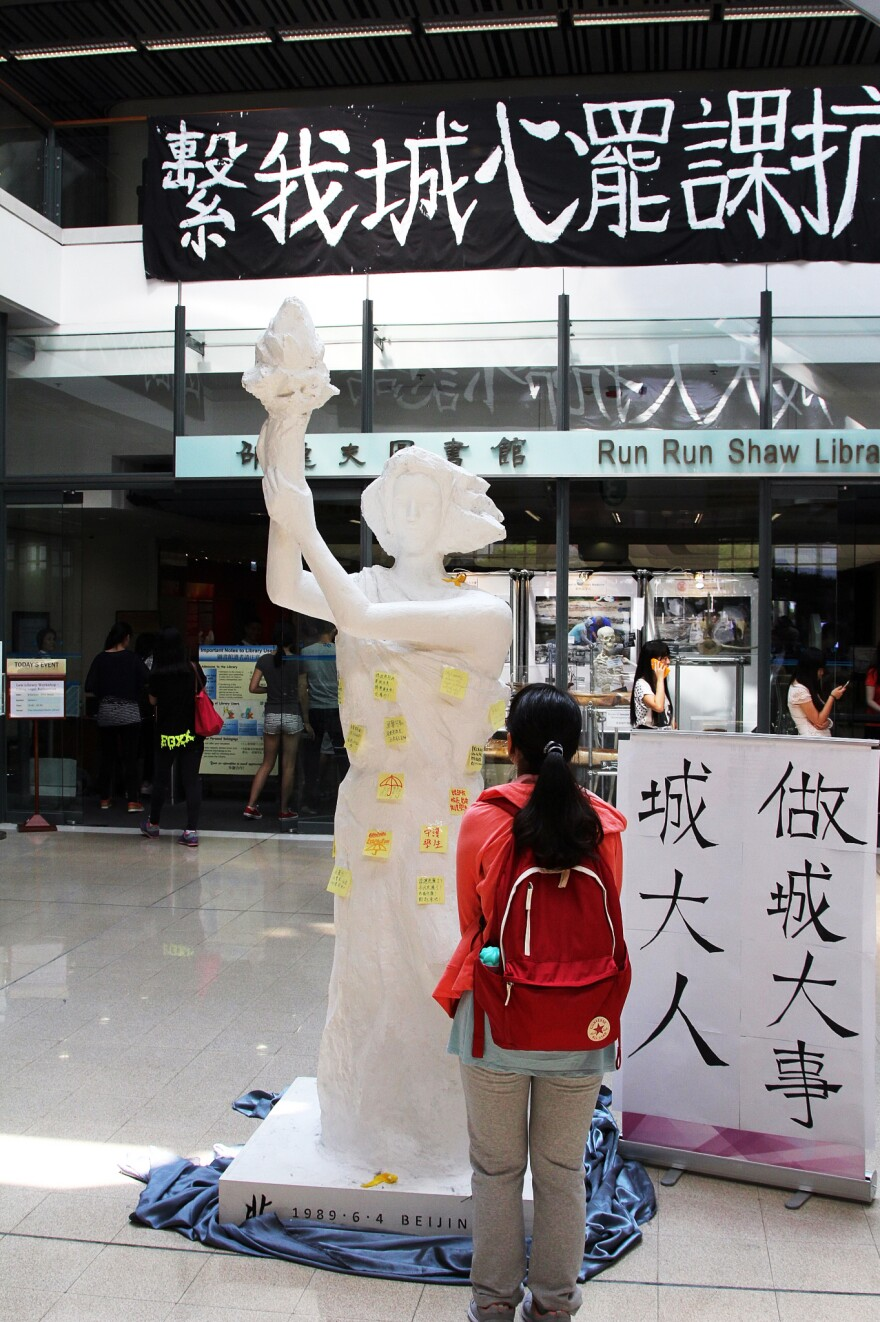 """In the lobby of City University of Hong Kong stands a replica of the """"Goddess of Democracy,"""" the famed statue that protesters built during the Tiananmen Square uprising in 1989. The Goddess was based on the Statue of Liberty."""