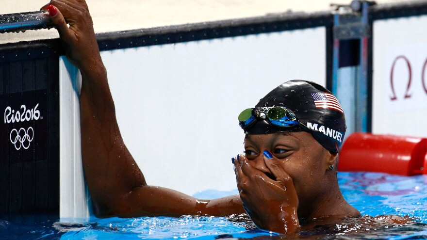 Simone Manuel of the United States celebrates after winning gold in the women's 100-meter freestyle at the Rio Summer Olympics.