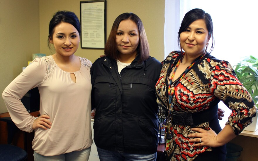 Charmayne Healy (left) and Miranda Kirk (right), co-founders of the Aaniiih Nakoda Anti-Drug Movement, have helped Melinda Healy (center) with their peer-support programs.