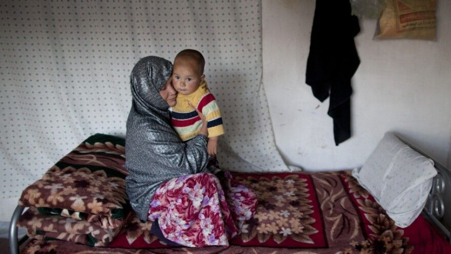 Sakina sits with her 18-month-old son, Shafiq, at a women's shelter in Bamiyan, in central Afghanistan, last October. Sakina spent seven months in prison for leaving a forced marriage. The Afghan government recently backed down from a plan to take control of women's shelters, and women's groups are hailing it as a victory.