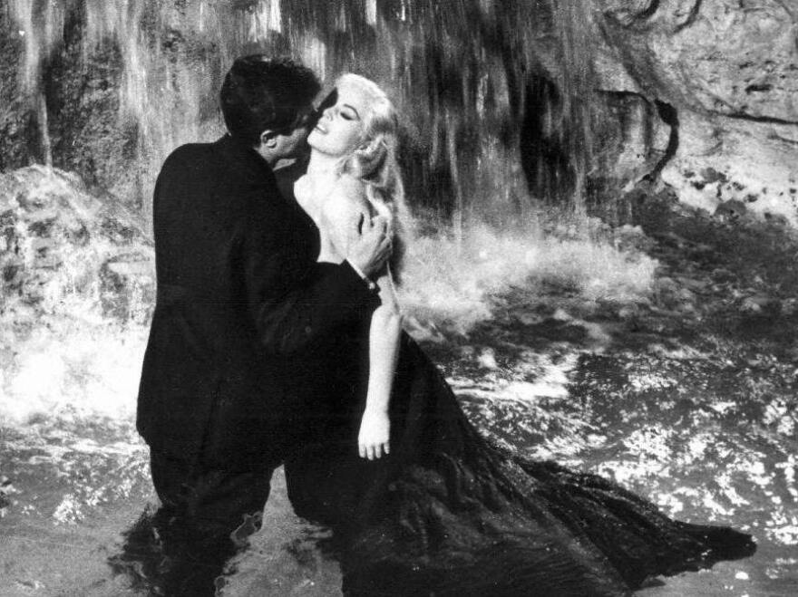 In director Federico Fellini<em></em>'s 1960 film <em>La Dolce Vita</em>, another journalist (Marcello Mastroianni) avails himself of the beauty of Rome, including Sylvia (Anita Ekberg) and the city's famous Fontana di Trevi.