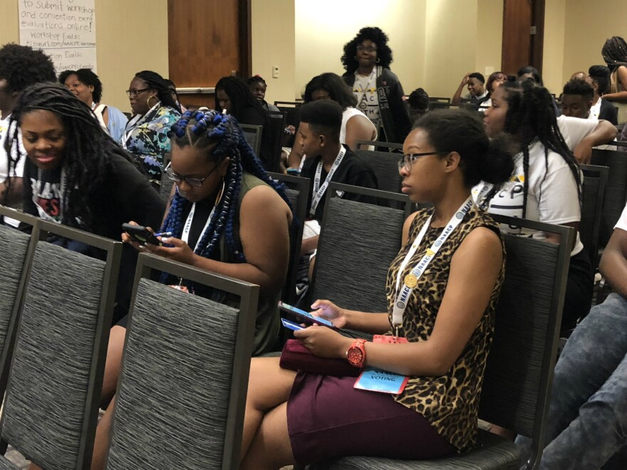 Candice Crutcher, right, joins an NAACP youth and college division workshop on campus hate crime July 17, 2018.