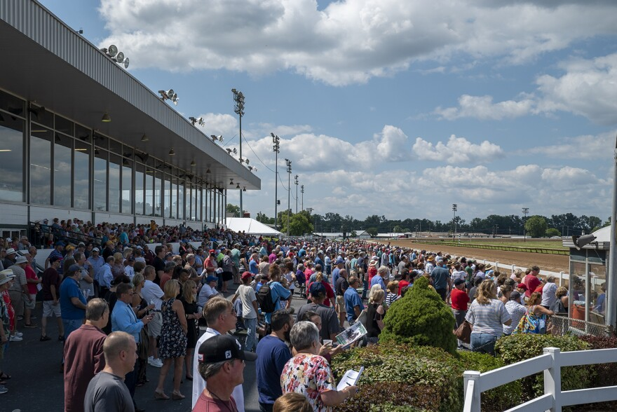 Hundreds of people clamor to see the track during one race on July 23.