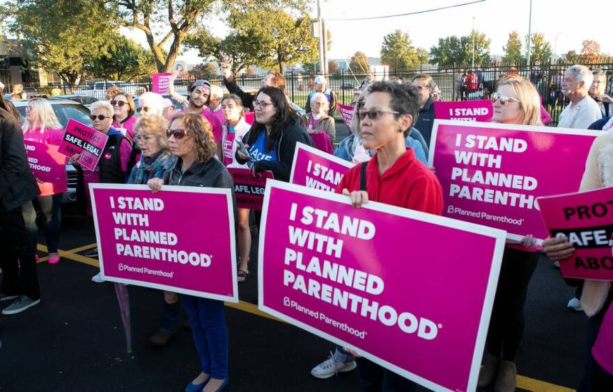 Planned Parenthood supporters listen to speakers during a rally and ribbon-cutting ceremony at the new Fairview Heights clinic on Oct. 21.