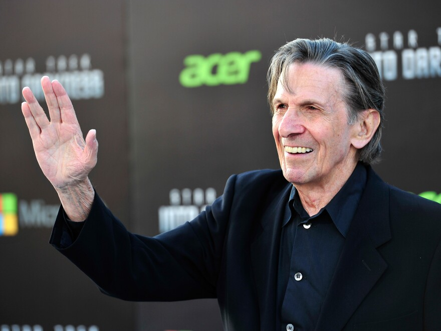 Nimoy flashes the famous Vulcan salute at the 2013 premiere of <em>Star Trek: Into Darkness</em>. He originally based the gesture on a Jewish blessing.