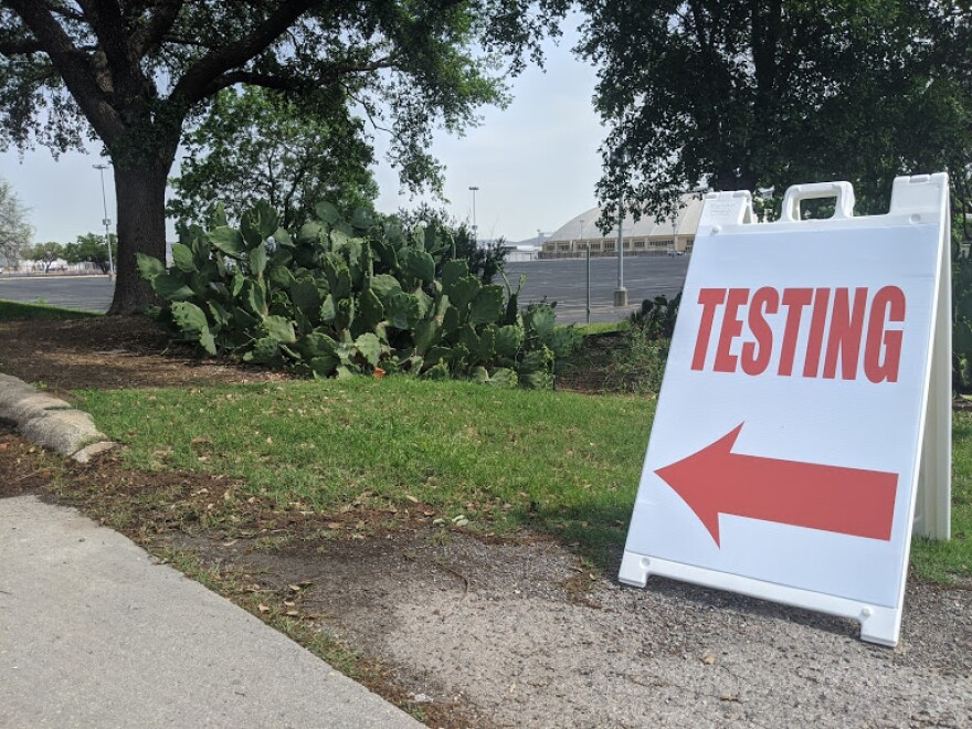 A sign directing people to testing at the Freeman Coliseum.