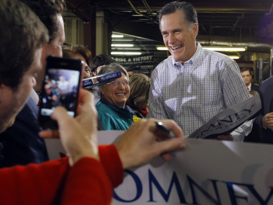 Former Massachusetts Governor Mitt Romney greets supporters during a campaign stop at Cherokee Trikes and More in Greer, S.C. on Thursday.