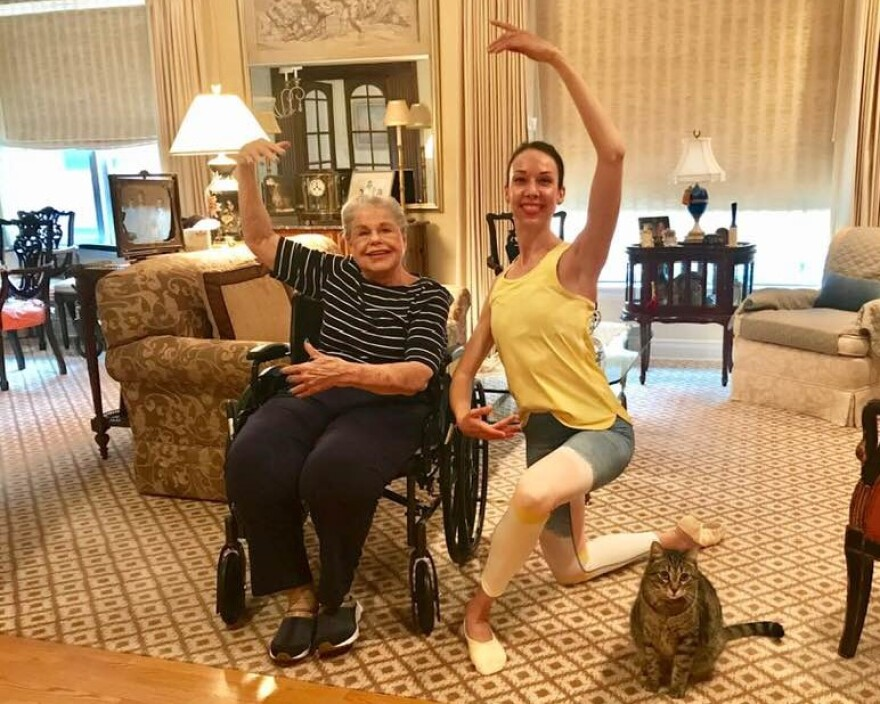 Joan Harrison poses with Vanessa Woods and Joan's cat, Macaroon, during one of their dance sessions.
