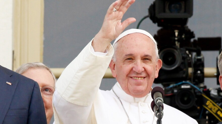 Pope Francis waves to the crowd after addressing Congress on Thursday.