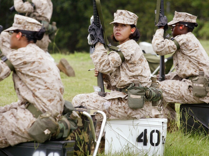 Female Marine Corps recruits train at the United States Marine Corps recruit depot June 21, 2004, in Parris Island, South Carolina. Some House Democrats and many veterans want the service of women and of all vets to be recognized in an updated motto for the Department of Veterans Affairs.