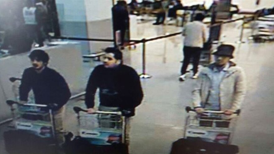 This image, provided by the Belgian Federal Police in Brussels, shows Najim Laachraoui (left), Ibrahim el Bakraoui (center) and a wanted suspect (right) whose whereabouts are currently unknown.