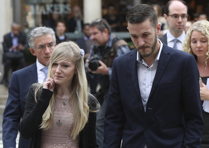 Chris Gard and Connie Yates, the parents of critically ill infant Charlie Gard, arrive at a court session in London on Monday.