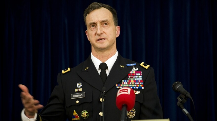 Brig. Gen. Mark Martins, the chief prosecutor at Guantanamo Bay, graduated first in his class at West Point, studied as a Rhodes scholar, and attended Harvard Law School. Here he speaks during a press conference at the military facility on Jan 18. following a hearing against Abd al-Rahim al-Nashiri, the main suspect in the bombing of the USS Cole in 2000.