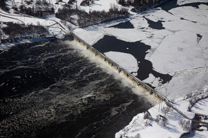 Large sheets of ice flow on top of the Mississippi River toward the Coon Rapids Dam in Coon Rapids, Minn., on Feb. 13, 2020.