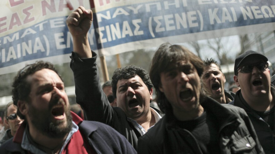 Shipyard workers demand their unpaid wages in central Athens on Thursday, the day that countries in the 17-nation euro zone formally approved a second bailout of $36.6 billion for Greece.
