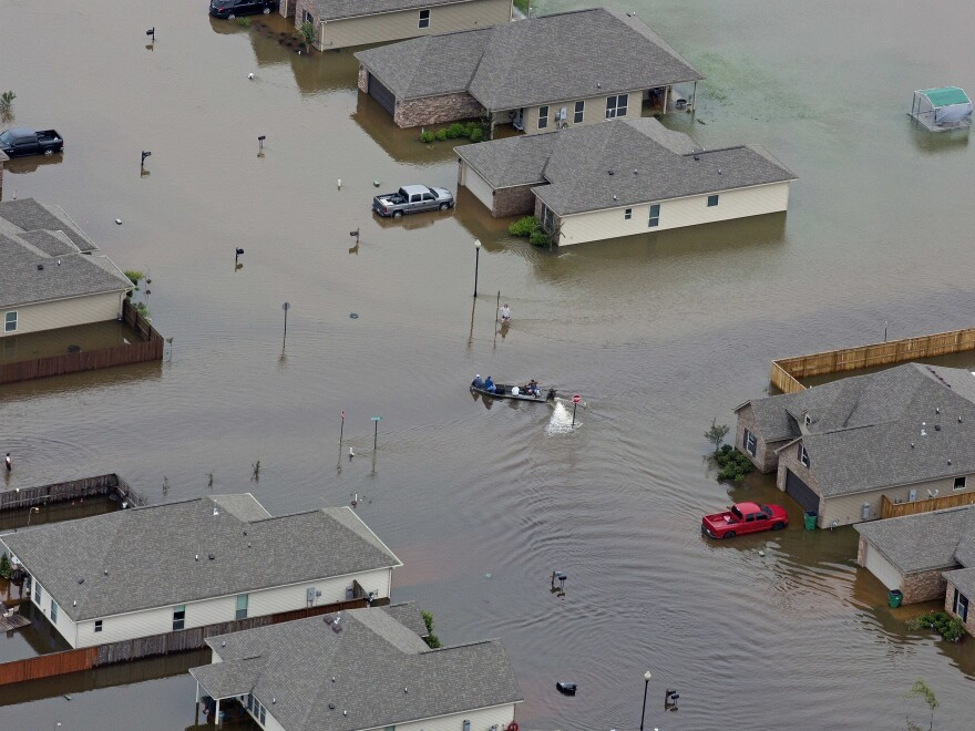 A boat floats between flooded homes in Hammond, La., after heavy rains inundated the southeastern part of the state.