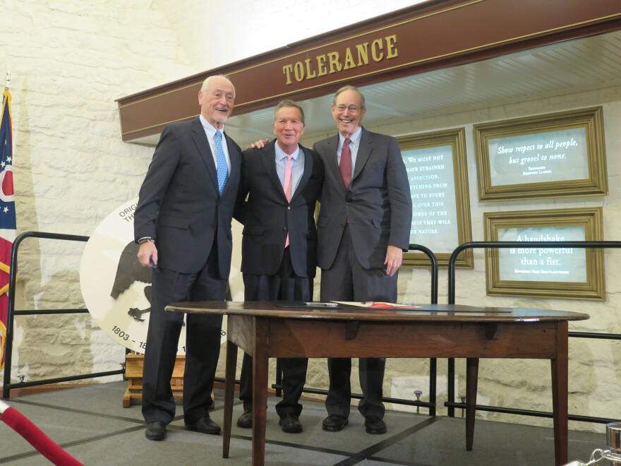Former Gov. Richard Celeste (D), Gov. John Kasich (R) and former Gov. Bob Taft (R) smile at the opening of the Ohio Constitution exhibit at the Statehouse in November 2018.